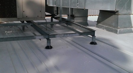 Back trays around all roof penetrations, with one functional dry pan under each side.